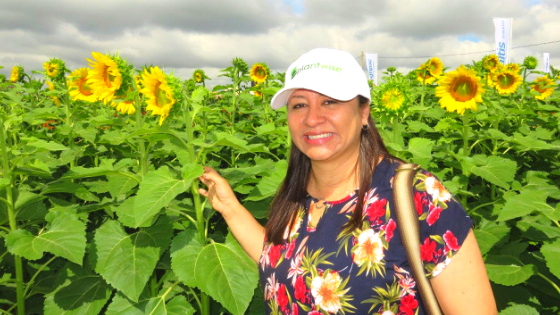 Yelitza Colmenarez in a sunflower field