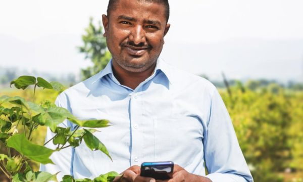 farmer in India holding mobile phone